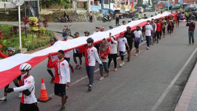 Photo of Gowaser Bentangkan Bendera 75 Meter Di Jembatan Poso